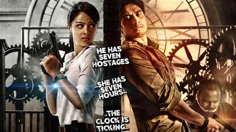 7 Hours To Go' revolves around the story of a man who holds 7 people as hostages after his girlfriend is murdered.