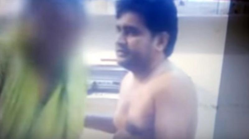 In her statement, the woman alleged that around 11 months back she was raped by Kumar when she had gone to his office in Outer Delhi's Sultanpuri seeking help to obtain a ration card. (Photo: Videograb)