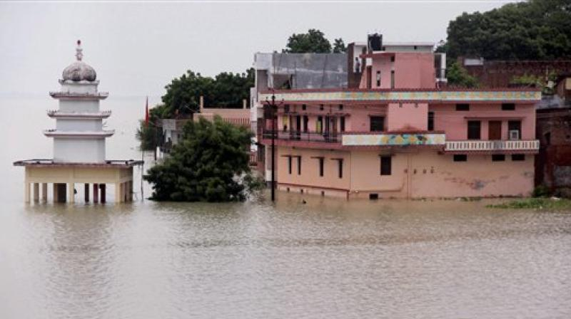 A view of submurged houses in water of River Ganga and Yamuna after water level rose second time in Allahabad. (Photo: PTI)
