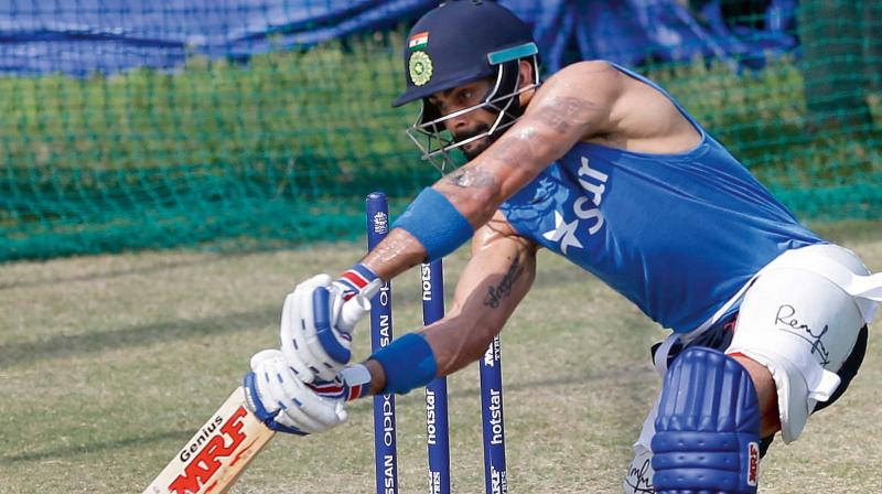 India's Virat Kohli bats in the nets during a practice session ahead of their ICC World Twenty20 2016 cricket match against Australia in Mohali (Photo: AP)
