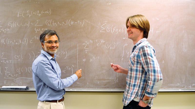 Mathematician Kannan Soundararajan with his colleague Robert Lemke Oliver.