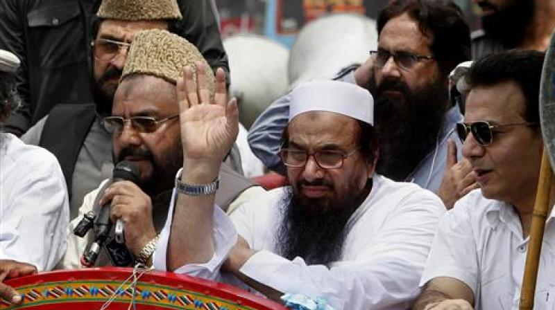 Pakistan's Hafiz Saeed, leader of a Pakistani religious group waves during an anti-Indian rally in Lahore, Pakistan. (Photo: AP)