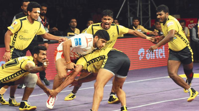 A slice of action from the Puneri Paltans and Telugu Titans clash in Bengaluru  on Friday.(Photo: Shashidhar B)
