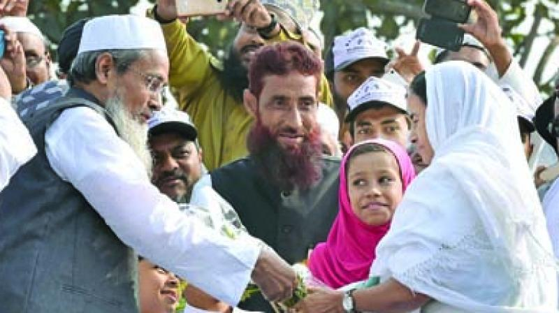Siddiqullah Chowdhury, General Secretary, Jamiat Ulema-e-Hind with West Bengal Chief Minister Mamata Banerjee. (Photo: PTI)