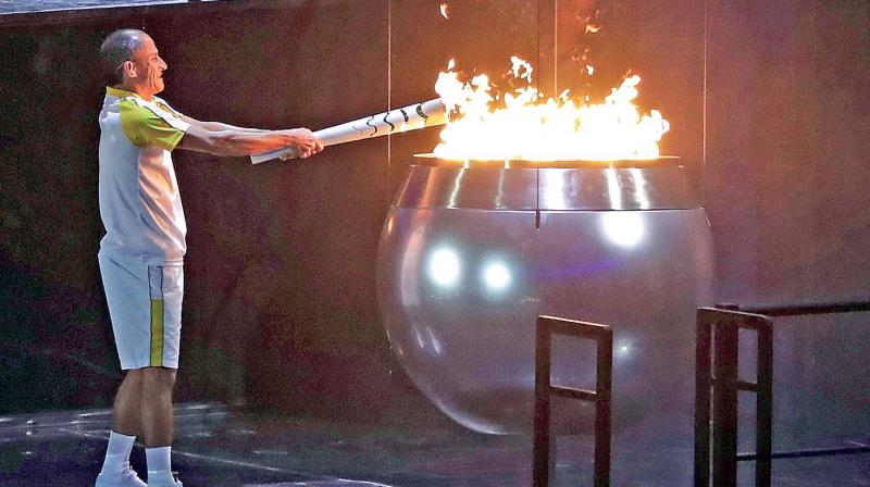 a5d6478c9844 Vanderlei de Lima lights the Olympic flame during the opening ceremony for  the 2016 Summer Olympics