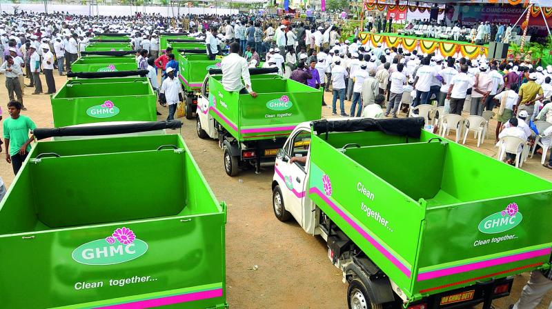 GHMC garbage vans assemble before the day's duties, in Hyderabad — File photo