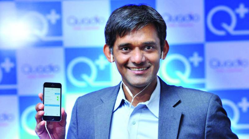 Anurag Sharma, Co-founder of Quadio, showing the Q+ app on a smart phone.