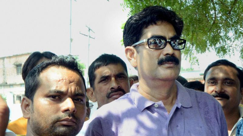 Former RJD MP Mohammad Shahabuddin with his supporters in Siwan. (Photo: PTI)
