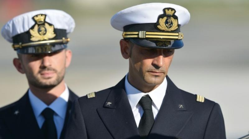 Undated photograph shows Italian marines Massimiliano Latorre and Salvatore Girone arriving at Ciampino airport near Rome. (Photo: AFP)