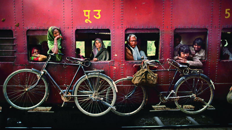 icycles hang on the side of a train, West Bengal, 1983. (Photo courtesy: India by Steve McCurry; Rs 3,500, pp 208; Published by Phaidon/Roli Books)