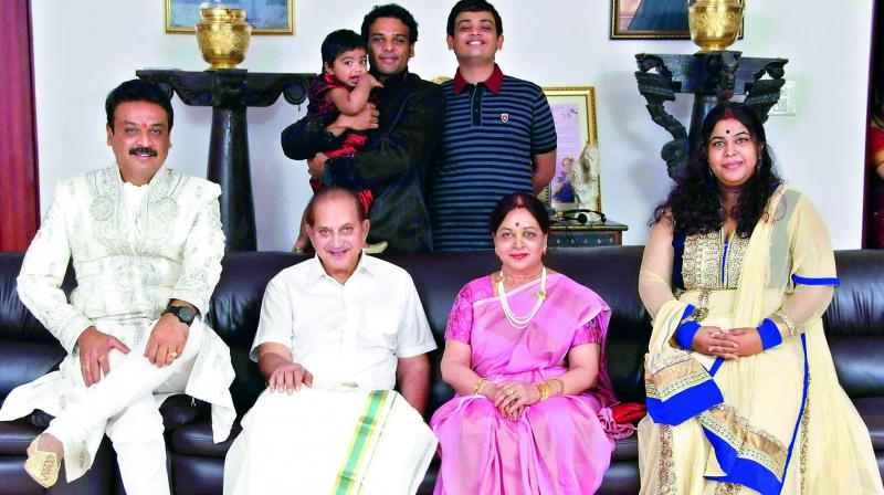 Naresh poses with his parents, wife and children