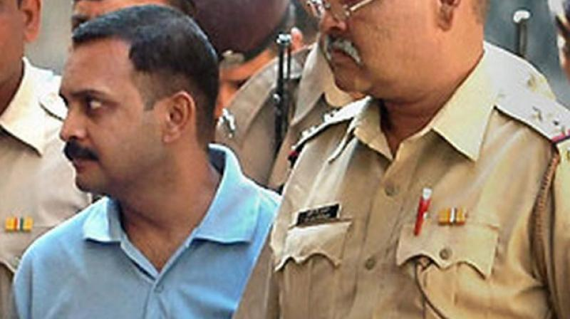 Malegaon blast case accused Lt Col Prasad Purohit being taken to a session court in Mumbai. (Photo: PTI/file)