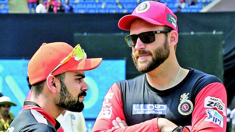Virat Kohli along with Daniel Vettori's