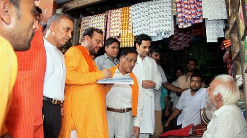 BJP committee memebers talking to local people during BJP's nine members committee visit in Kairana. (Photo: PTI)