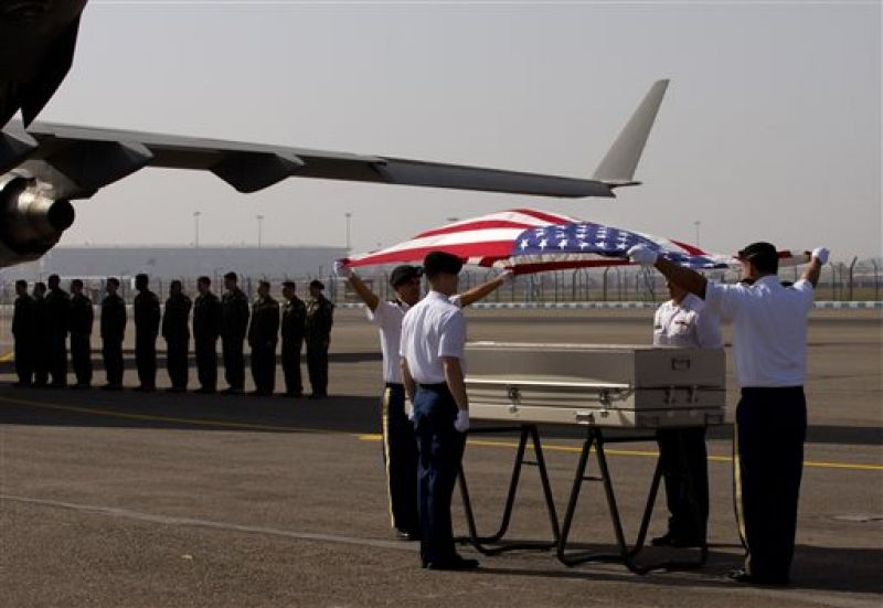 US military members paying their final respects  at a ceremony at the Palam airport, in New Delhi. (Photo: AP)