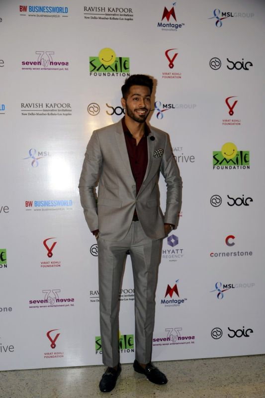 Team India cricketer Hardik Pandya looked dapper as he didn't hesitate posing for photographers at the do.