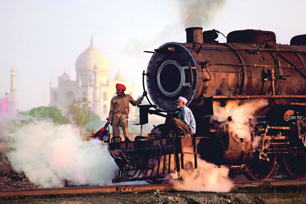 Steam engine passes in front of the Taj Mahal, Agra, Uttar Pradesh, 1983