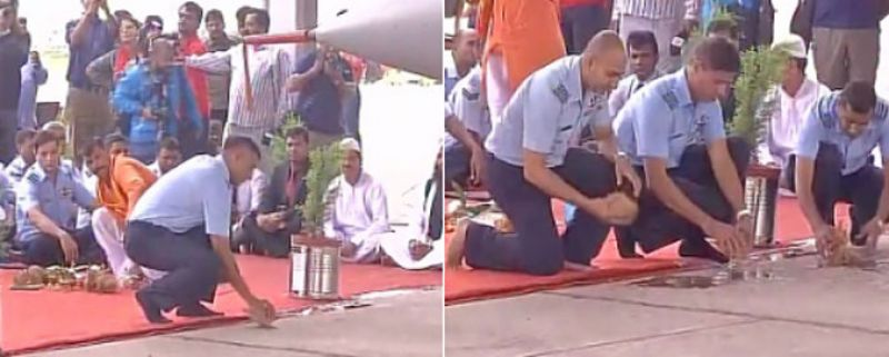 Air Force personnel break coconuts as a traditional ritual to bring good luck. (Photo: Twitter/ANI)