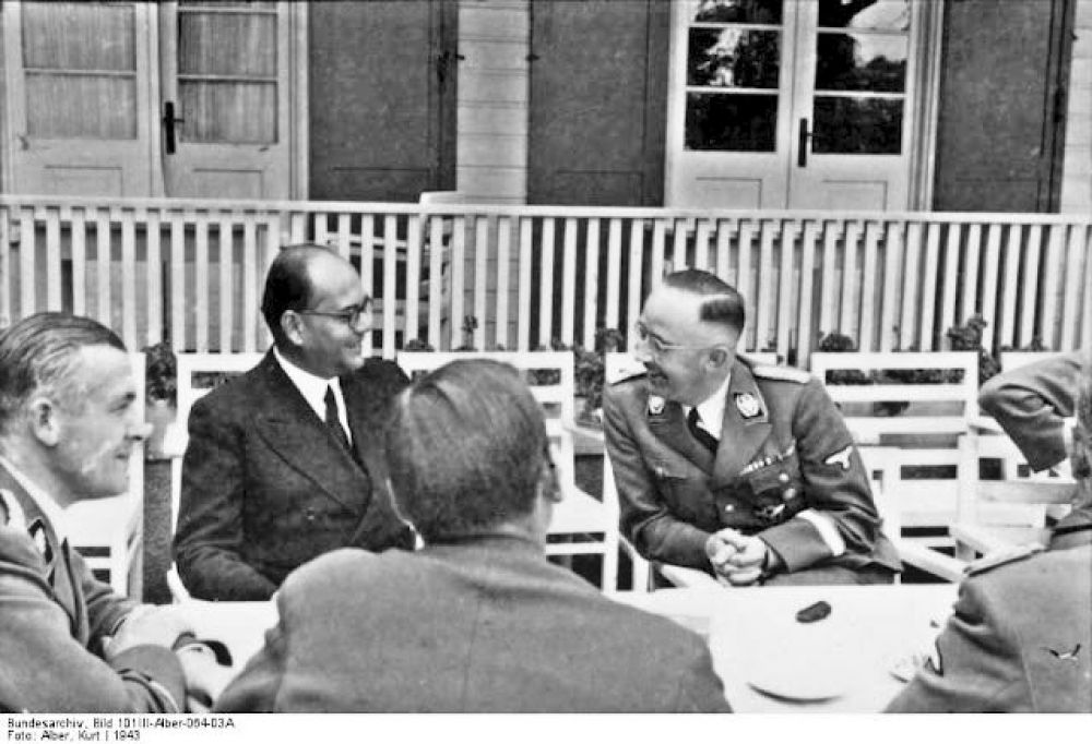 At the table: Subhash Chandra Bose talks to officials from Nazi Germany, including Heinrich Himmler, third from left.