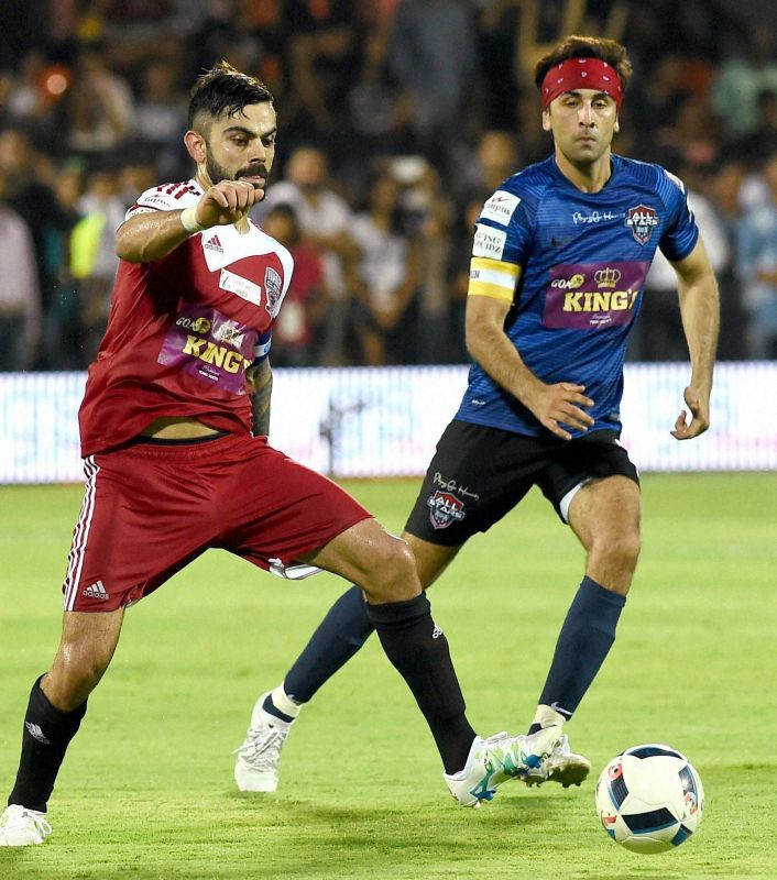 Virat Kohli and Ranbir Kapoor snapped during the match. (Photo: PTI)