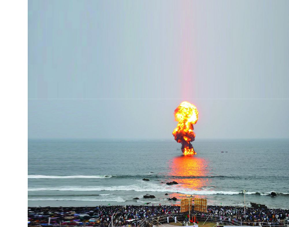 A made-up oil rig turns into flames after it was set fire by navy personnel during the Operations Demonstration.